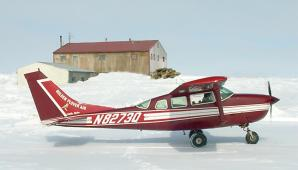 Cessna-206 on wheels on river ice